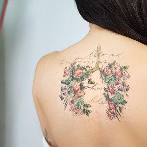 tattoo de flores para mujer