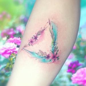 tatuaje femenino de flores para mujer