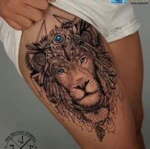 tatuaje en la pierna de leon