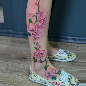 tatuajes en la pierna de orquídeas