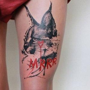 tatuaje de lince en la pierna